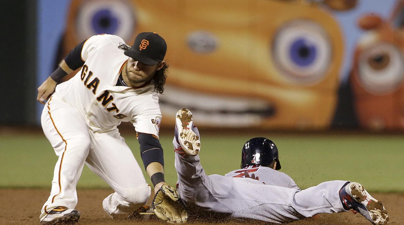 Washington Nationals' Trea Turner, right, steals second base next to San Francisco Giants shortstop Brandon Crawford during the eighth inning of a baseball game in San Francisco, Thursday, July 28, 2016. (AP Photo/Jeff Chiu)