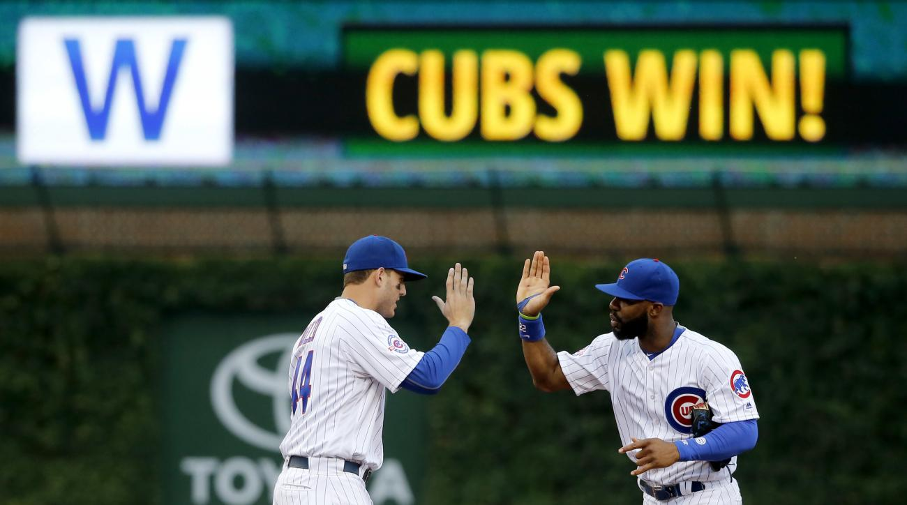 Chicago Cubs first baseman Anthony Rizzo, left, and Jason Heyward celebrate the Cubs' 12-1 win over the Seattle Mariners after a baseball game Friday, July 29, 2016, in Chicago. (AP Photo/Charles Rex Arbogast)