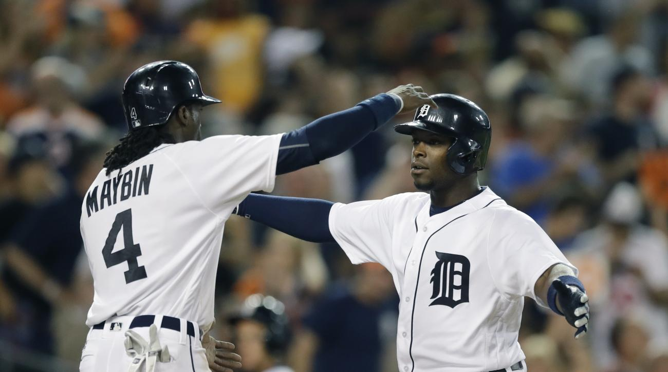 Detroit Tigers' Justin Upton, right, is greeted at home plate by Cameron Maybin after they scored on Upton's three-run home run during the sixth inning of a baseball game against the Houston Astros, Friday, July 29, 2016, in Detroit. (AP Photo/Carlos Osor