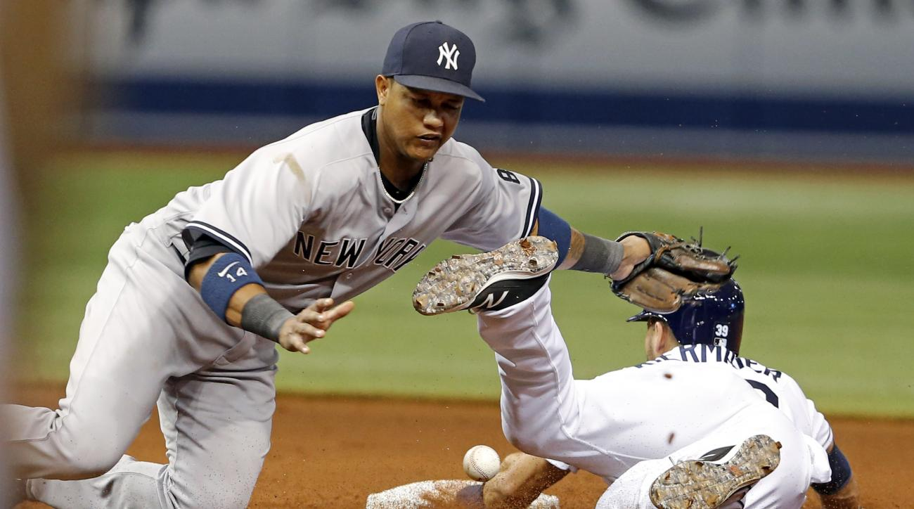 Tampa Bay Rays' Kevin Kiermaier steals second base as New York Yankees second baseman Starlin Castro cannot handle the throw during the seventh inning of a baseball game Friday, July 29, 2016, in St. Petersburg, Fla. (AP Photo/Mike Carlson)