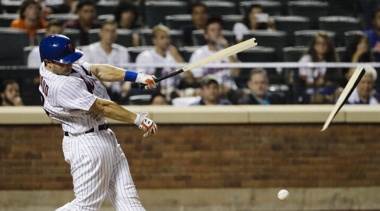 New York Mets' Travis d'Arnaud breaks his bat while hitting a single during the eighth inning of a baseball game against the Colorado Rockies, Friday, July 29, 2016, in New York. (AP Photo/Frank Franklin II)