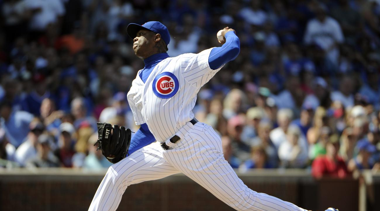 Chicago Cubs relief pitcher Aroldis Chapman (54) throws against the Seattle Mariners during the eighth inning of an interleague baseball game, Saturday, July 30, 2016, in Chicago. (AP Photo/David Banks)