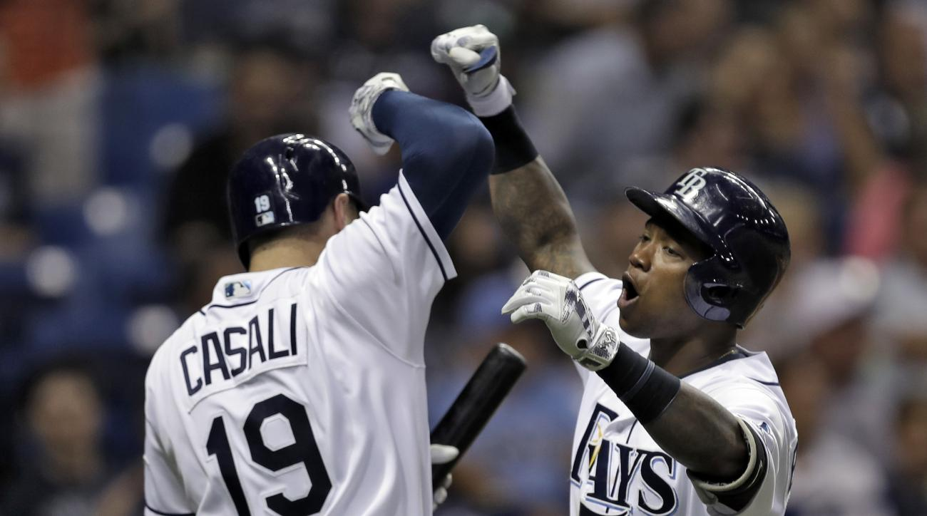 Tampa Bay Rays' Tim Beckham, right, celebrates with Curt Casali after his two-run home run off New York Yankees relief pitcher Anthony Swarzak during the seventh inning of a baseball game Saturday, July 30, 2016, in St. Petersburg, Fla. (AP Photo/Chris O'