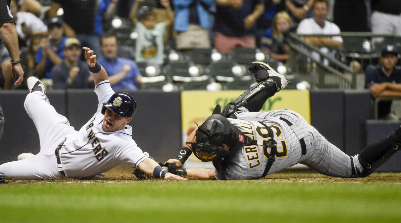 Pittsburgh Pirates catcher Francisco Cervelli, right, tags out Milwaukee Brewers' Scooter Gennett, left, during the seventh inning of a baseball game Saturday, July 30, 2016, in Milwaukee. (AP Photo/Benny Sieu)