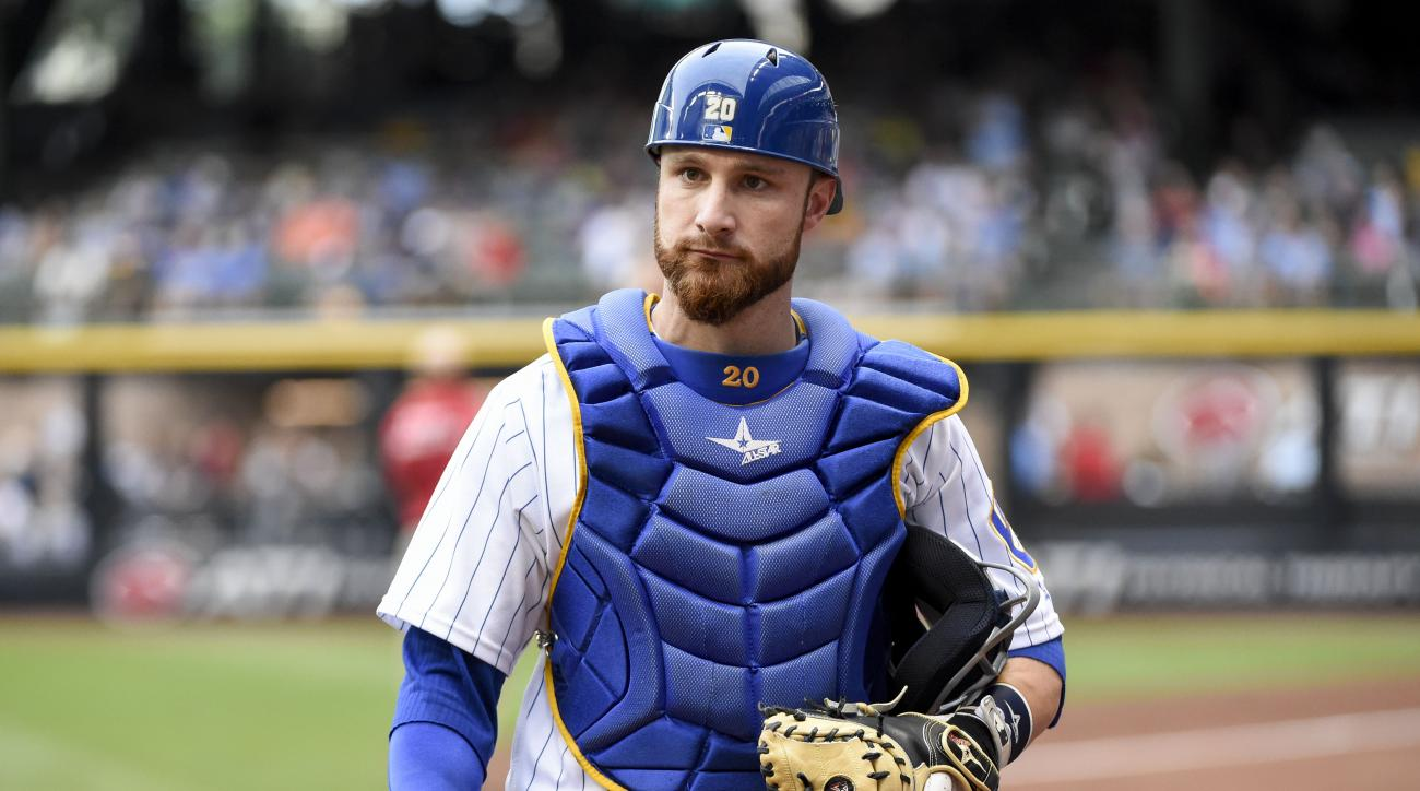 FILE- In this July 29, 2016, file photo, Milwaukee Brewers catcher Jonathan Lucroy gets ready before a baseball game against the Pittsburgh Pirates in Milwaukee. The Cleveland Indians could be nearing a trade for Milwaukee All-Star catcher Jonathan Lucroy
