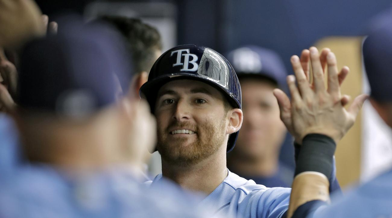Tampa Bay Rays' Brad Miller high-fives teammates in the dugout after his home run off New York Yankees starting pitcher Michael Pineda during the fifth inning of a baseball game Sunday, July 31, 2016, in St. Petersburg, Fla. (AP Photo/Chris O'Meara)
