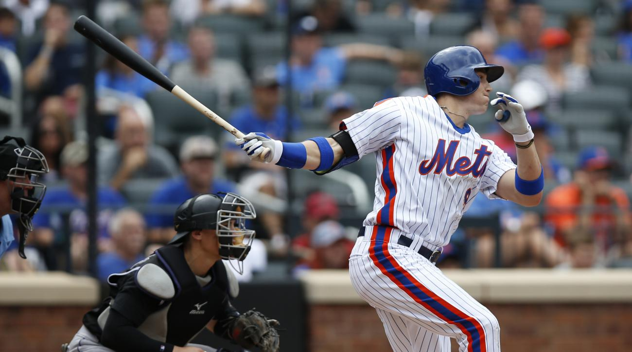 New York Mets' Brandon Nimmo, right, hits a third-inning RBI-single in a baseball game against the Colorado Rockies, Sunday, July 31, 2016, in New York. (AP Photo/Kathy Willens)