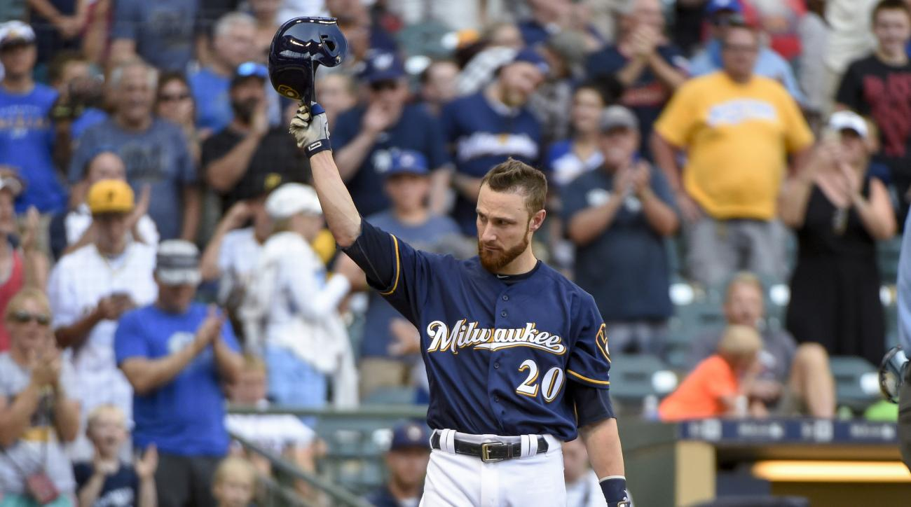 Milwaukee Brewers' Jonathan Lucroy tips his cap after getting a standing ovation from fans while pinch-hitting during the eighth inning of a baseball game against the Pittsburgh Pirates on Sunday, July 31, 2016, in Milwaukee. Lucky stopped a trade to the