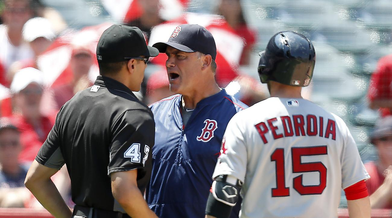 Boston Red Sox manager John Farrell, middle, yells at umpire Gabe Morales after Red Sox second baseman Dustin Pedroia, right, struck out during the fifth inning of a baseball game against the Los Angeles Angels, Sunday, July 31, 2016, in Anaheim, Calif. F