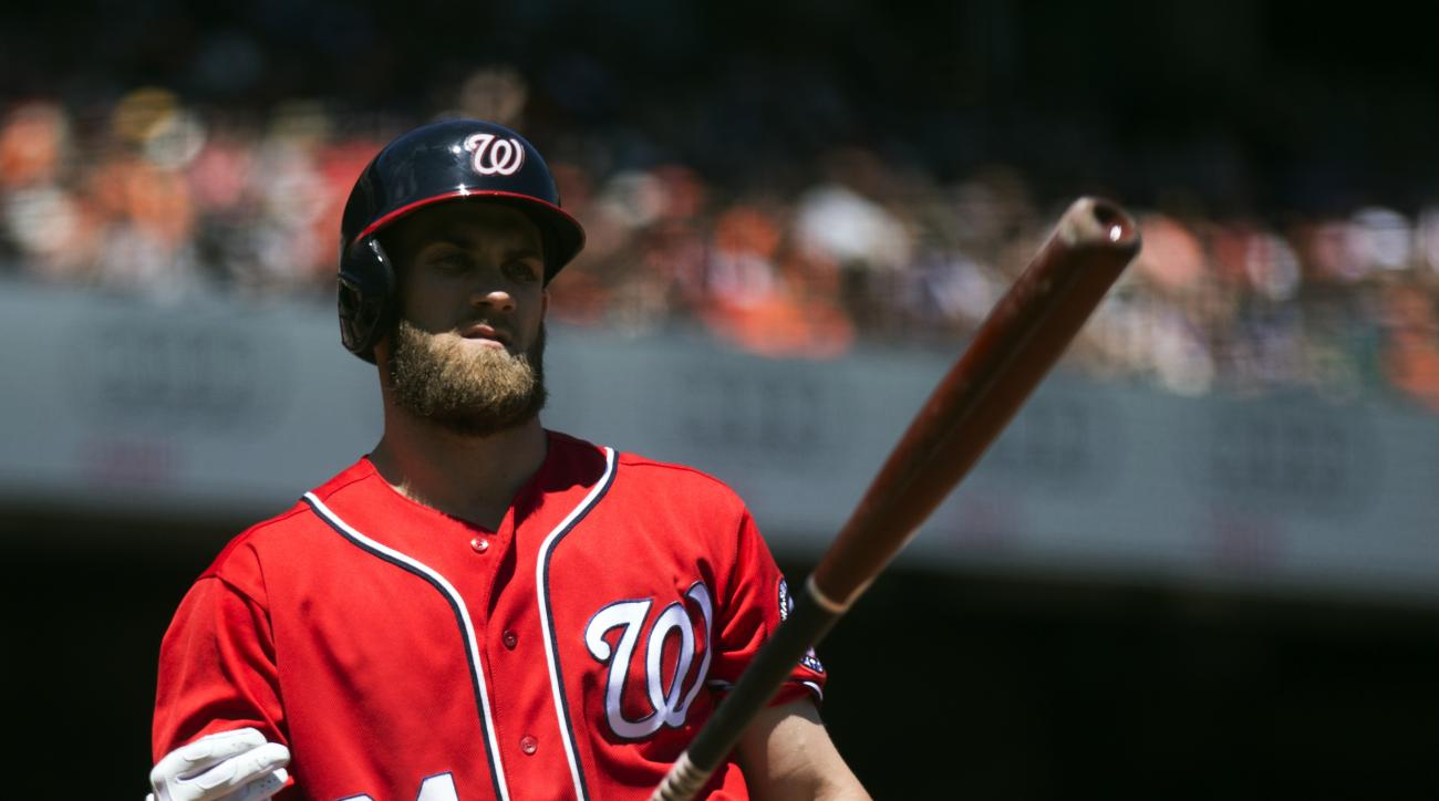 Washington Nationals' Bryce Harper (34) flips his bat after striking out against the San Francisco Giants during the third inning of a baseball game on Sunday, July 31, 2016, in San Francisco. (AP Photo/D. Ross Cameron)