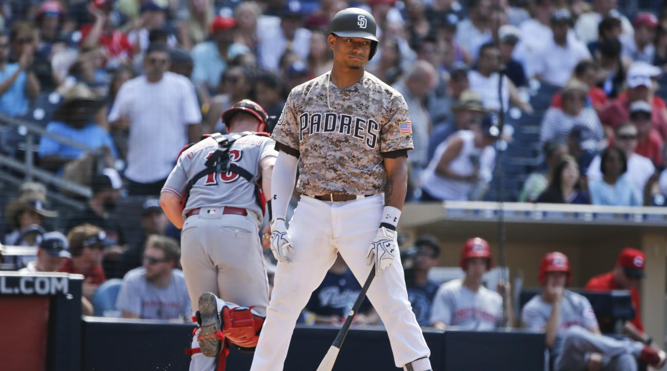 San Diego Padres' Christian Bethancourt stands at home plate after taking a third strike to end the Padres' threat against the Cincinnati Reds in the sixth inning of a baseball game Sunday, July 31, 2016, in San Diego. (AP Photo/Lenny Ignelzi)