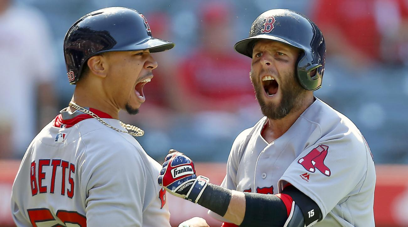 Boston Red Sox's Dustin Pedroia, right, celebrates with Mookie Betts, left, after hitting a three-run home run in the ninth inning of a baseball game, Sunday, July 31, 2016, in Anaheim, Calif. (AP Photo/Ryan Kang)