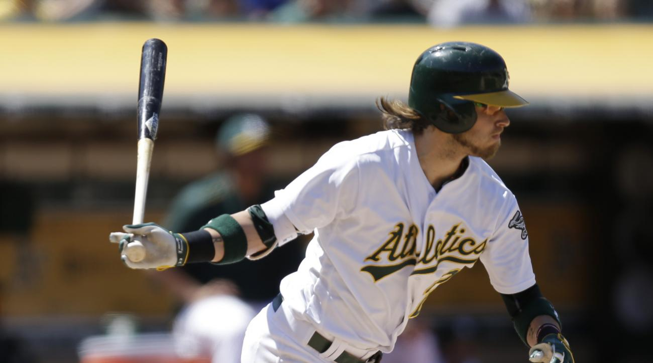 FILE - In this July 16, 2016, file photo, Oakland Athletics' Josh Reddick swings against the Toronto Blue Jays in the seventh inning of a baseball game, in Oakland, Calif. The Athletics traded right fielder Josh Reddick and left-hander Rich Hill to the co