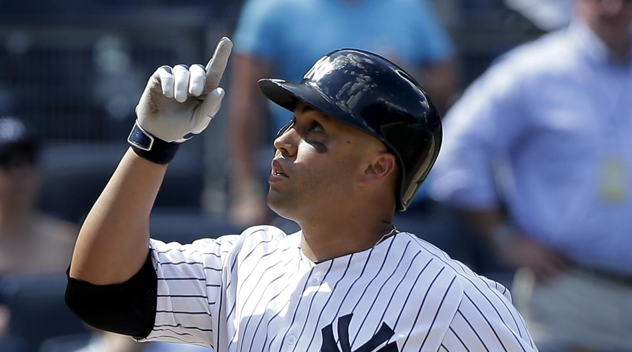 FILE - In this June 22, 2016, file photo, New York Yankees' Carlos Beltran reacts as he crosses the plate after hitting a three-run home run against the Colorado Rockies during the seventh inning of a baseball game, in New York. The Yankees stepped up the