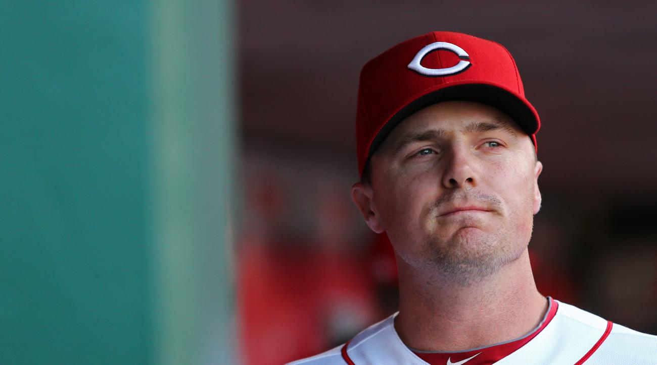 FILE - In this June 9, 2016, file photo, Cincinnati Reds right fielder Jay Bruce looks on from the dugout during the first inning inning of a baseball game against the St. Louis Cardinals, in Cincinnati. The New York Mets have acquired All-Star outfielder