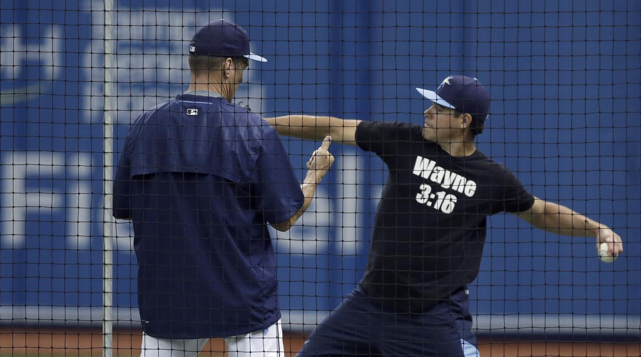 Tampa Bay Rays pitching coach Jim Hickey, left, talks to starting pitcher Matt Moore as he throws before a baseball game, Monday, Aug. 1, 2016, in St. Petersburg, Fla. Moore was traded to the San Francisco Giants at the trading deadline. (AP Photo/Chris O