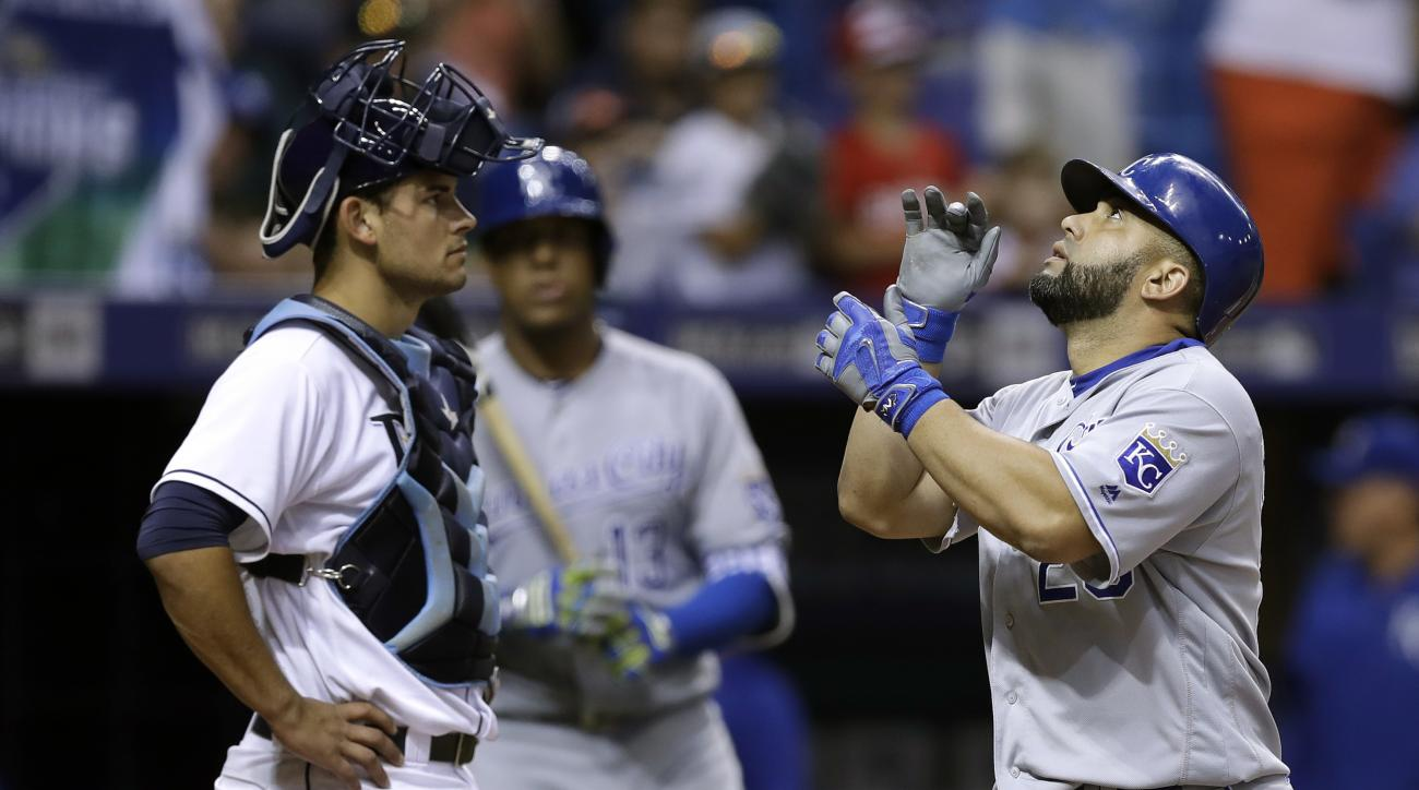Kansas City Royals' Kendrys Morales, right, reacts in front of Tampa Bay Rays catcher Luke Maile after hitting a home run off starting pitcher Chris Archer during the seventh inning of a baseball game, Monday, Aug. 1, 2016, in St. Petersburg, Fla. (AP Pho