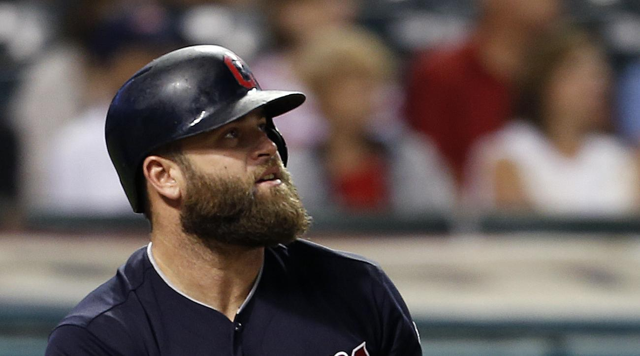 Cleveland Indians' Mike Napoli watches his two run home run off Minnesota Twins relief pitcher Buddy Boshers during the eighth inning of a baseball game, Monday, Aug. 1, 2016, in Cleveland. (AP Photo/Ron Schwane)