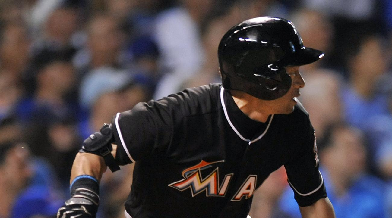 Miami Marlins' Ichiro Suzuki watches as he lines out to Chicago Cubs third baseman Kris Bryant during the fifth inning of a baseball game, Monday, Aug. 1, 2016, in Chicago. (AP Photo/Paul Beaty)