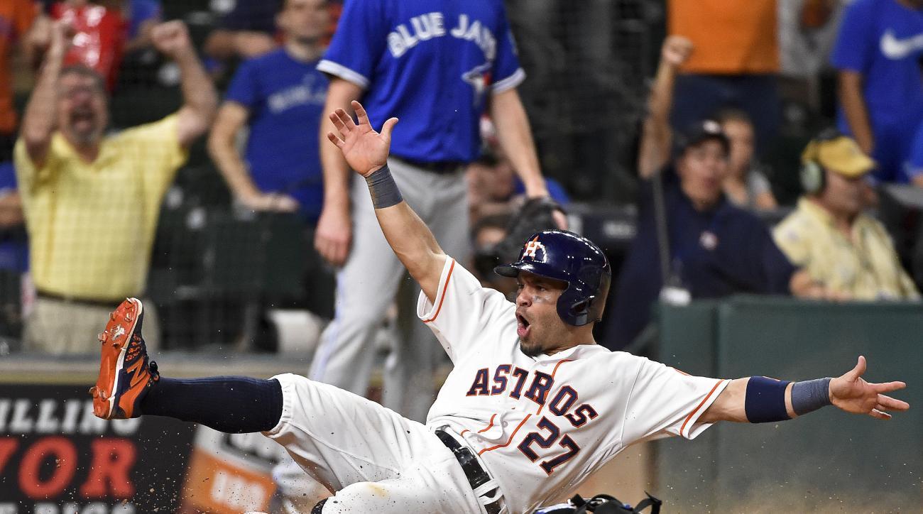 Houston Astros' Jose Altuve scores the winning run on Carlos Correa's single in the 14th inning of a baseball game against the Toronto Blue Jays, Monday, Aug. 1, 2016, in Houston. Houston won 2-1. (AP Photo/Eric Christian Smith)