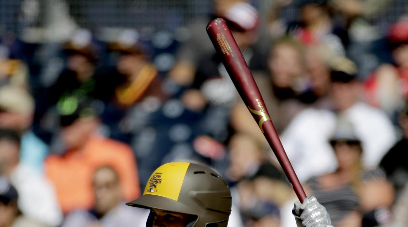 U.S. Team's Andrew Benintendi, of the Boston Red Sox, hits against the World Team during the first inning of the All-Star Futures baseball game, Sunday, July 10, 2016, in San Diego. (AP Photo/Matt York)