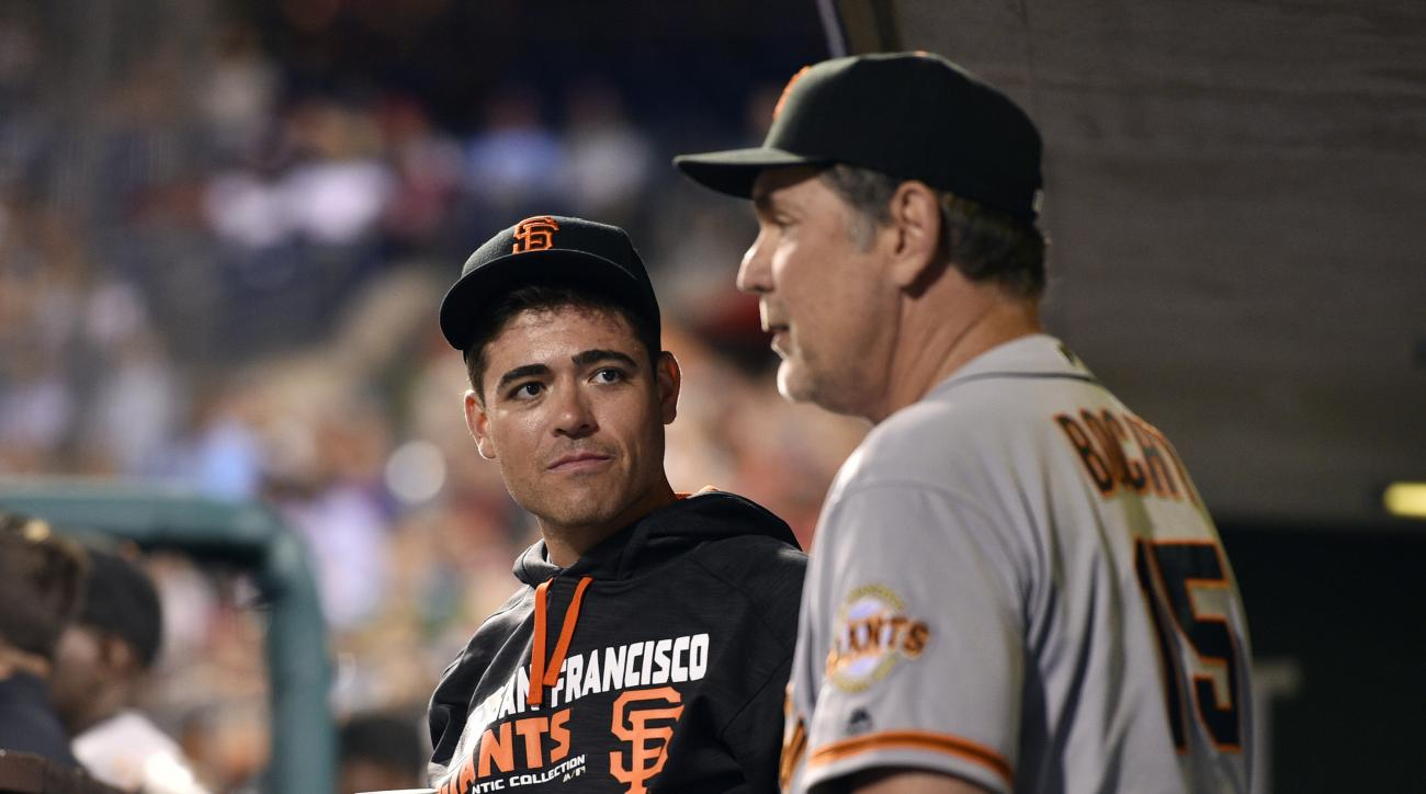 San Francisco Giants' Matt Moore, left, talks to manager Bruce Bochy in the dugout during a baseball game against the Philadelphia Phillies, Tuesday, Aug. 2, 2016, in Philadelphia. (AP Photo/Derik Hamilton)