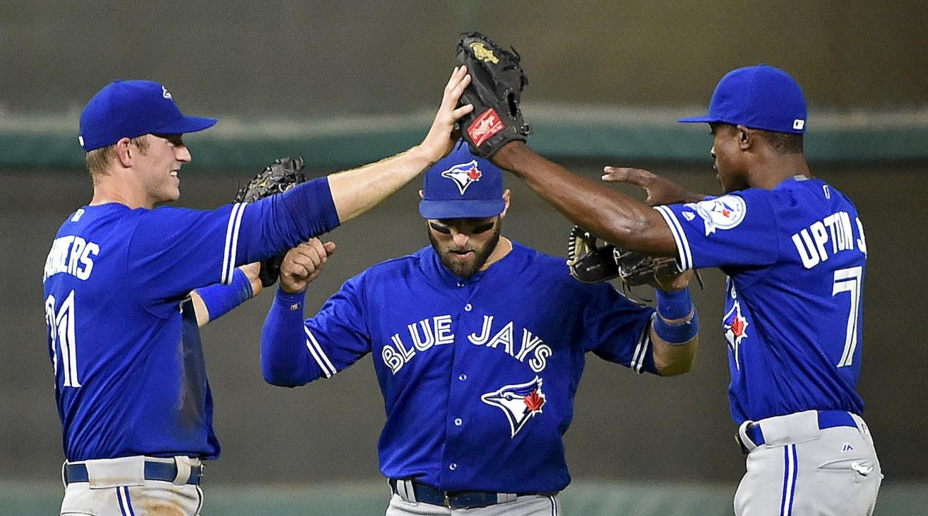Toronto Blue Jays' Michael Suanders, left, Kevin Pillar, center, and Melvin Upton Jr. celebrate their victory over the Houston Astros in a baseball game, Tuesday, Aug. 2, 2016, in Houston. (AP Photo/Eric Christian Smith)
