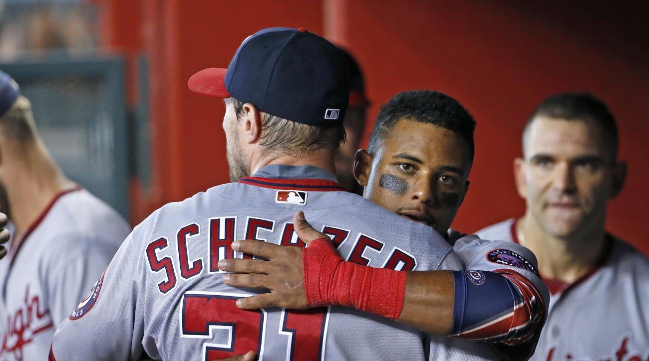Washington Nationals' Max Scherzer, left, gets a hug from Wilmer Difo after Scherzer finished pitching the after the eighth inning of a baseball game against the Arizona Diamondbacks Wednesday, Aug. 3, 2016, in Phoenix. The Nationals defeated the Diamondb