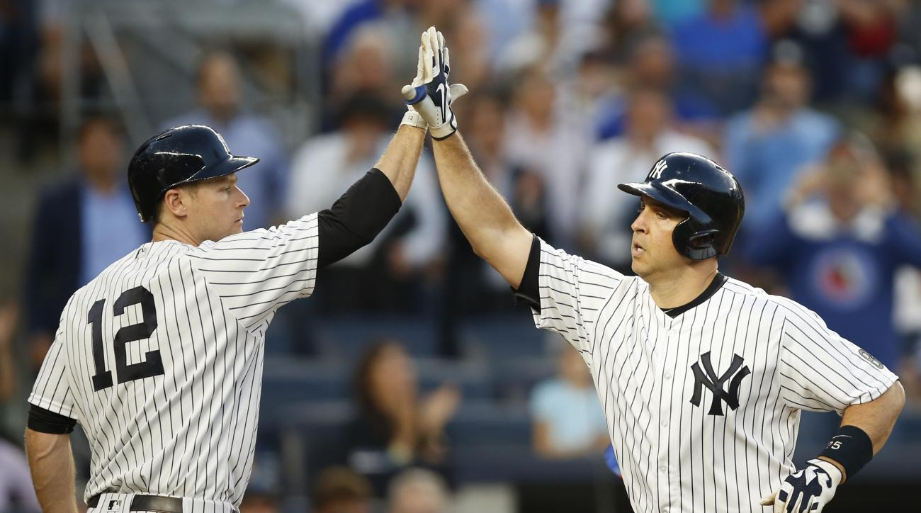 New York Yankees on-deck batter Chase Headley (12) congratulates Mark Teixeira after Teixeira hit a three-run home run during the second inning against the New York Mets in a baseball game Wednesday, Aug. 3, 2016, in New York. (AP Photo/Kathy Willens)