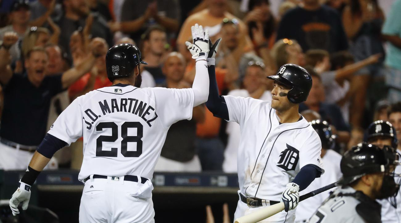 Detroit Tigers' J.D. Martinez (28) celebrates with Jose Iglesias after hitting a solo home run off Chicago White Sox pitcher Chris Sale during the eighth inning of a baseball game Wednesday, Aug. 3, 2016, in Detroit. (AP Photo/Paul Sancya)