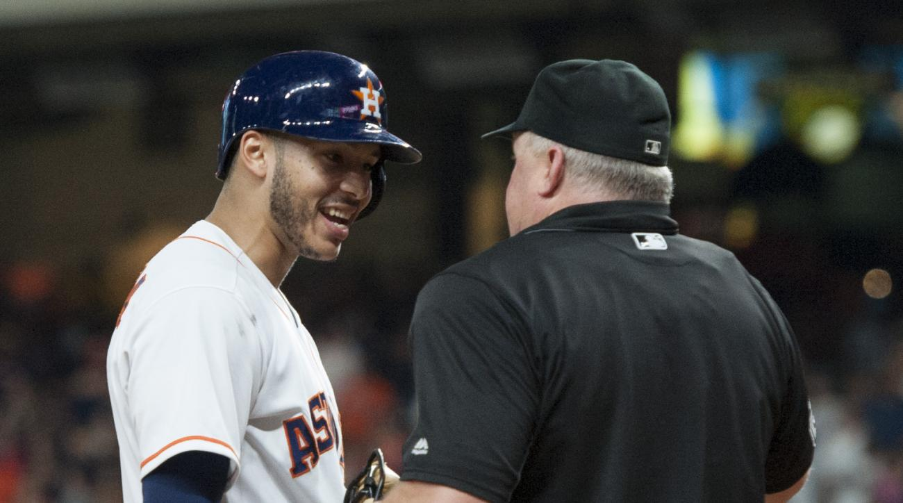Houston Astros' Carlos Correa questions a called third strike by home plate umpire Bill Miller during the eighth inning of the Astros' baseball game against the Toronto Blue Jays on Wednesday, Aug. 3, 2016, in Houston. (AP Photo/George Bridges)