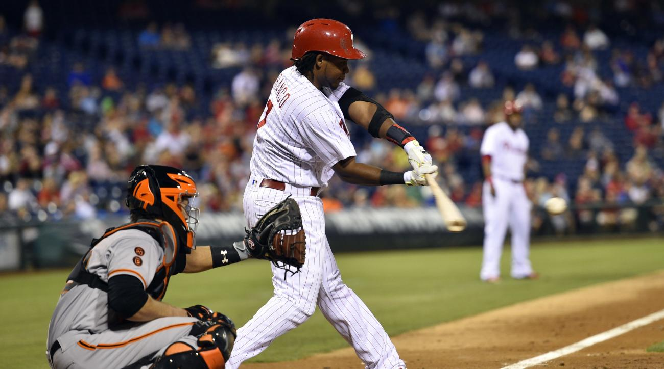 Philadelphia Phillies' Maikel Franco hits a two-run single during the eighth inning of a baseball game against the San Francisco Giants, Wednesday, Aug. 3, 2016, in Philadelphia. The Phillies won 5-4 in 12 innings. (AP Photo/Derik Hamilton)