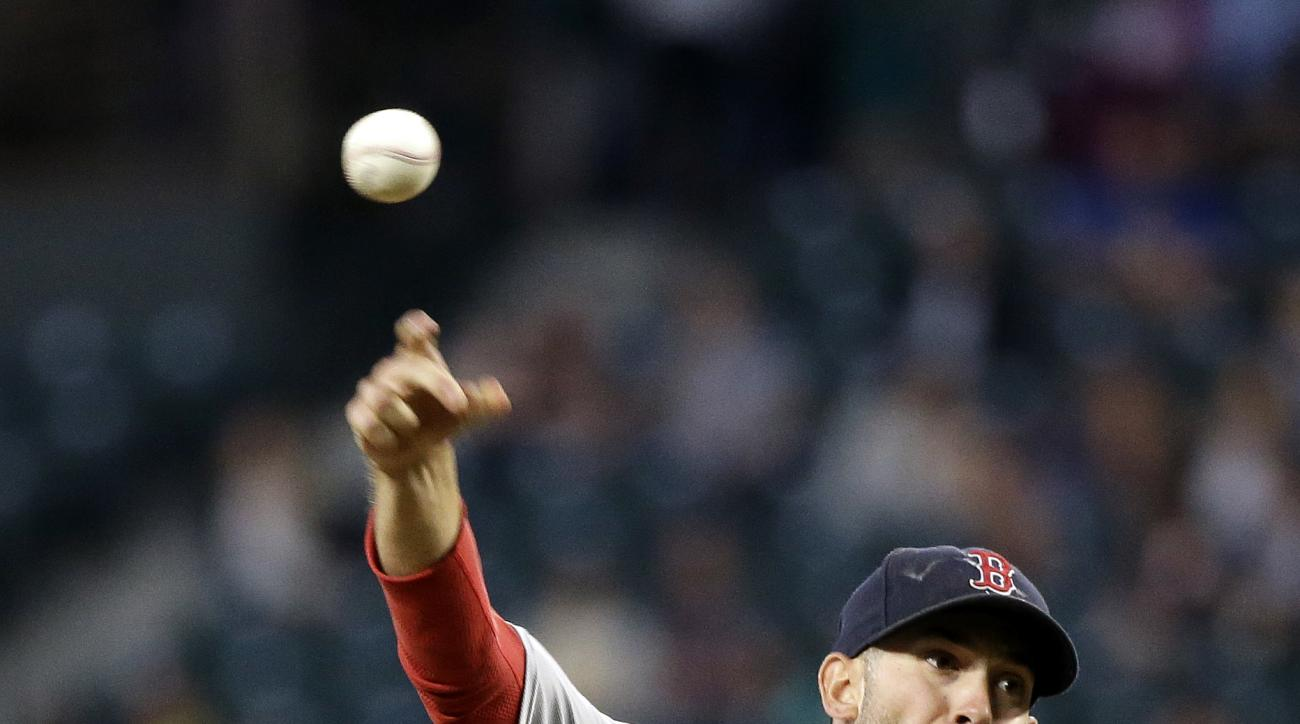 Boston Red Sox starting pitcher Rick Porcello throws against the Seattle Mariners during the sixth inning of a baseball game Wednesday, Aug. 3, 2016, in Seattle. (AP Photo/Elaine Thompson)