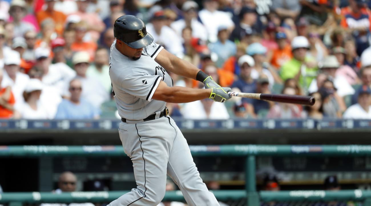 Chicago White Sox's Jose Abreu hits a two-run home run against the Detroit Tigers in the second inning of a baseball game Thursday, Aug. 4, 2016 in Detroit. (AP Photo/Paul Sancya)