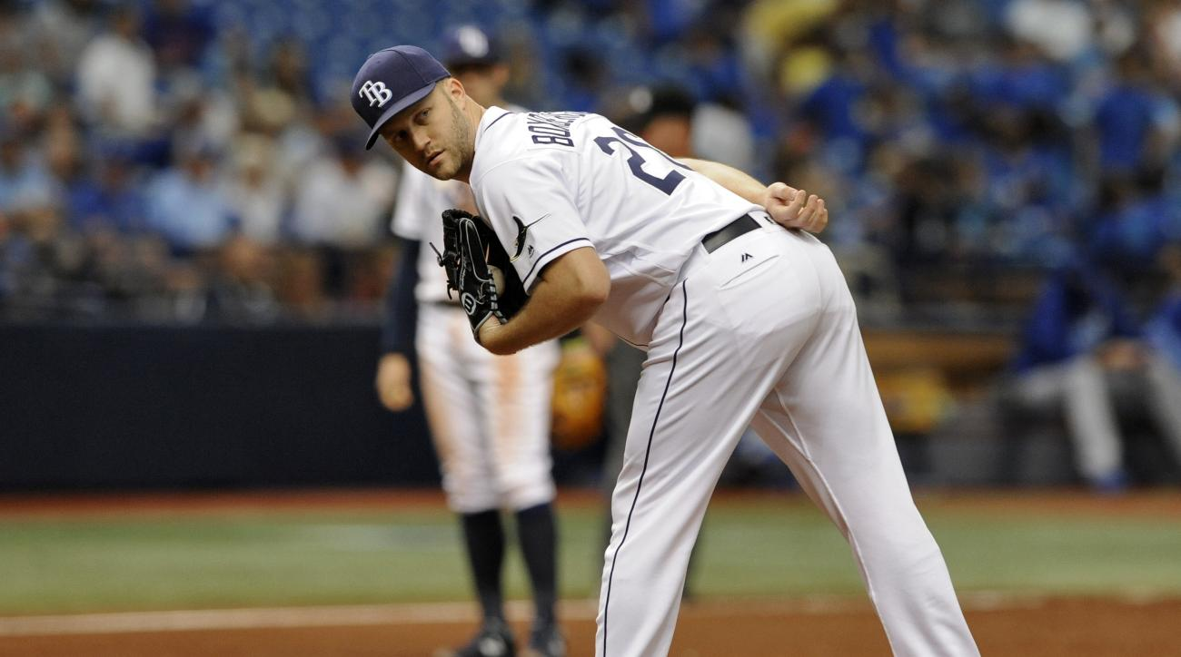 Tampa Bay Rays deliver Brad Boxberger checks a runner at first base during the eighth inning of a baseball game against the Kansas City Royals Thursday, Aug. 4, 2016, in St. Petersburg, Fla. (AP Photo/Steve Nesius)