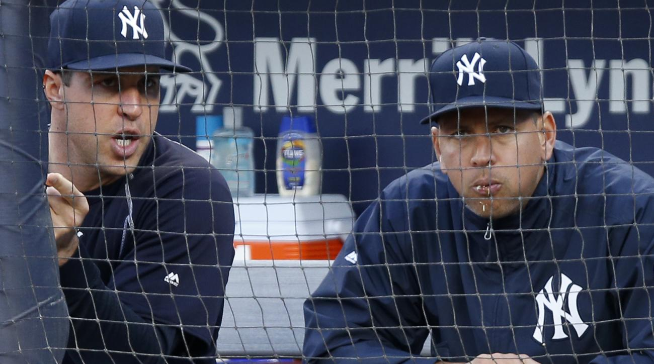 New York Yankees' Mark Teixeira, left, Alex Rodriguez sit out the team's baseball game against the New York Mets, Thursday, Aug. 4, 2016, in New York. (AP Photo/Kathy Willens)