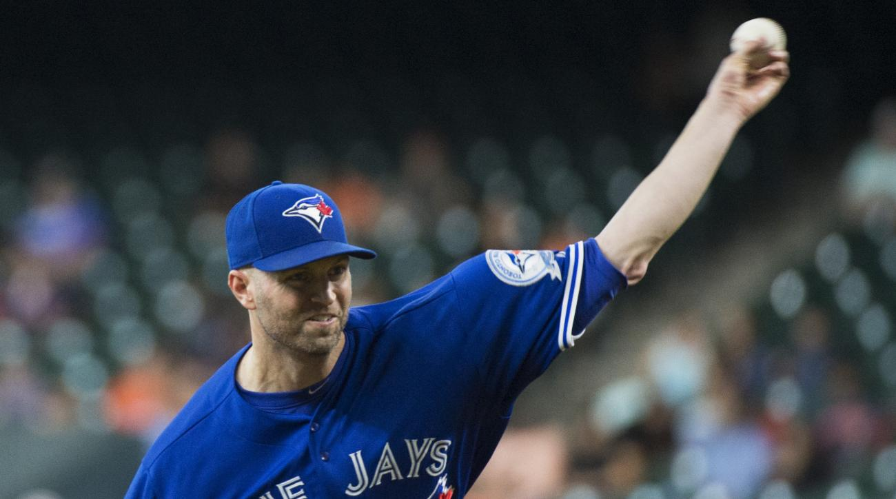 Toronto Blue Jays' J.A. Happ (pitches against the Houston Astros during the first inning of a baseball game Thursday, Aug. 4, 2016, in Houston. (AP Photo/George Bridges)