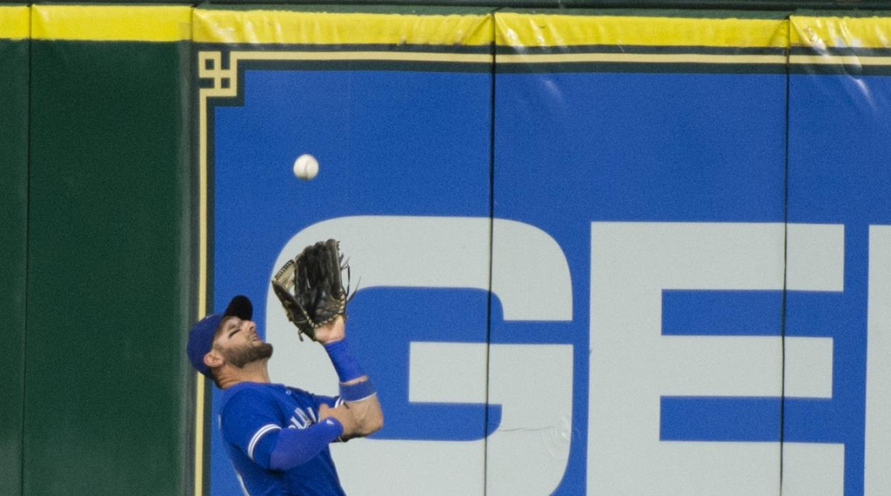 Toronto Blue Jays center fielder Kevin Pillar catches a fly ball hit by Houston Astros' Alex Bregman during the fourth inning of a baseball game Thursday, Aug. 4, 2016, in Houston. (AP Photo/George Bridges)