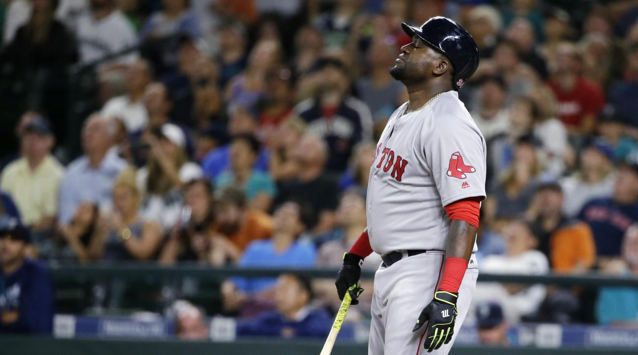 Boston Red Sox designated hitter David Ortiz stands with his eyes closed after he popped out to Seattle Mariners second baseman Robinson Cano during the eighth inning of a baseball game, Thursday, Aug. 4, 2016, in Seattle. (AP Photo/Ted S. Warren)