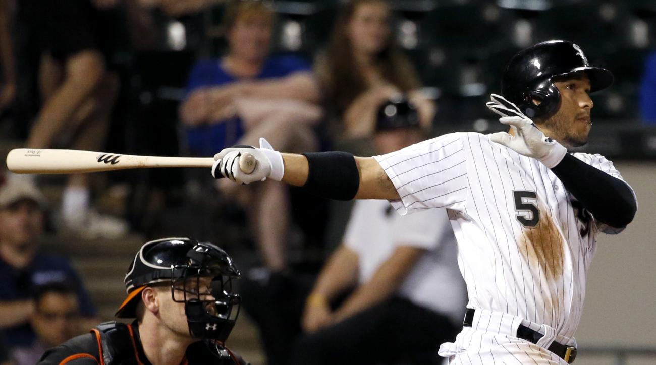 Chicago White Sox's Carlos Sanchez hits a two-run double during the eighth inning of a baseball game against the Baltimore Orioles Friday, Aug. 5, 2016, in Chicago. (AP Photo/Nam Y. Huh)