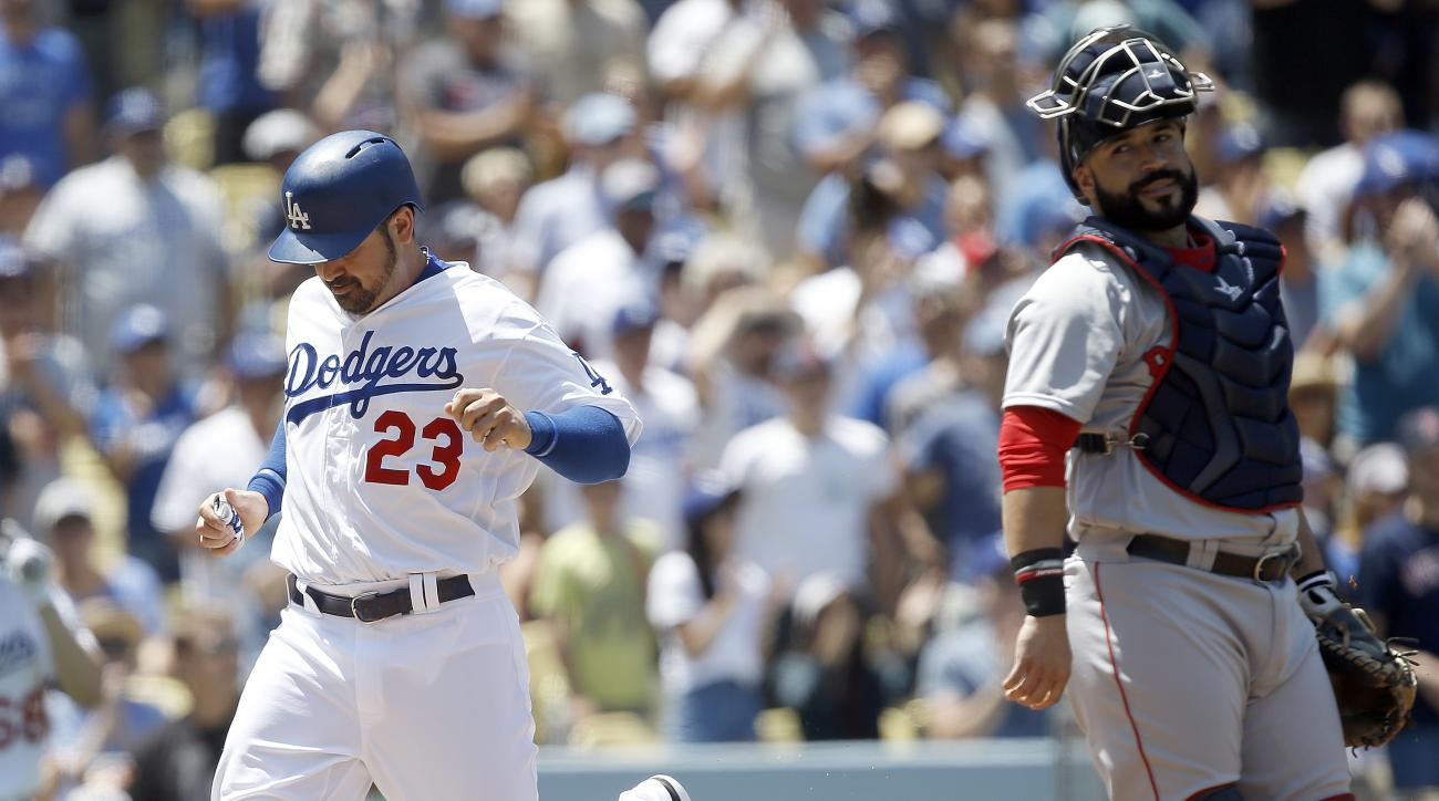 Los Angeles Dodgers' Adrian Gonzalez, left, scores on a single by A.J. Ellis, with Boston Red Sox catcher Sandy Leon, right, looking over during the second inning of a baseball game in Los Angeles, Saturday, Aug. 6, 2016. (AP Photo/Alex Gallardo)