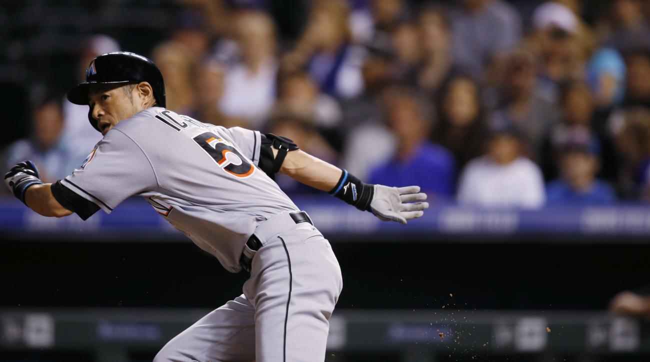 Miami Marlins pinch-hitter Ichiro Suzuki runs up the first base line to beat out an infield hit for a single off Colorado Rockies relief pitcher Jordan Lyles in the eighth inning of a baseball game Saturday, Aug. 6, 2016, in Denver. (AP Photo/David Zalubo