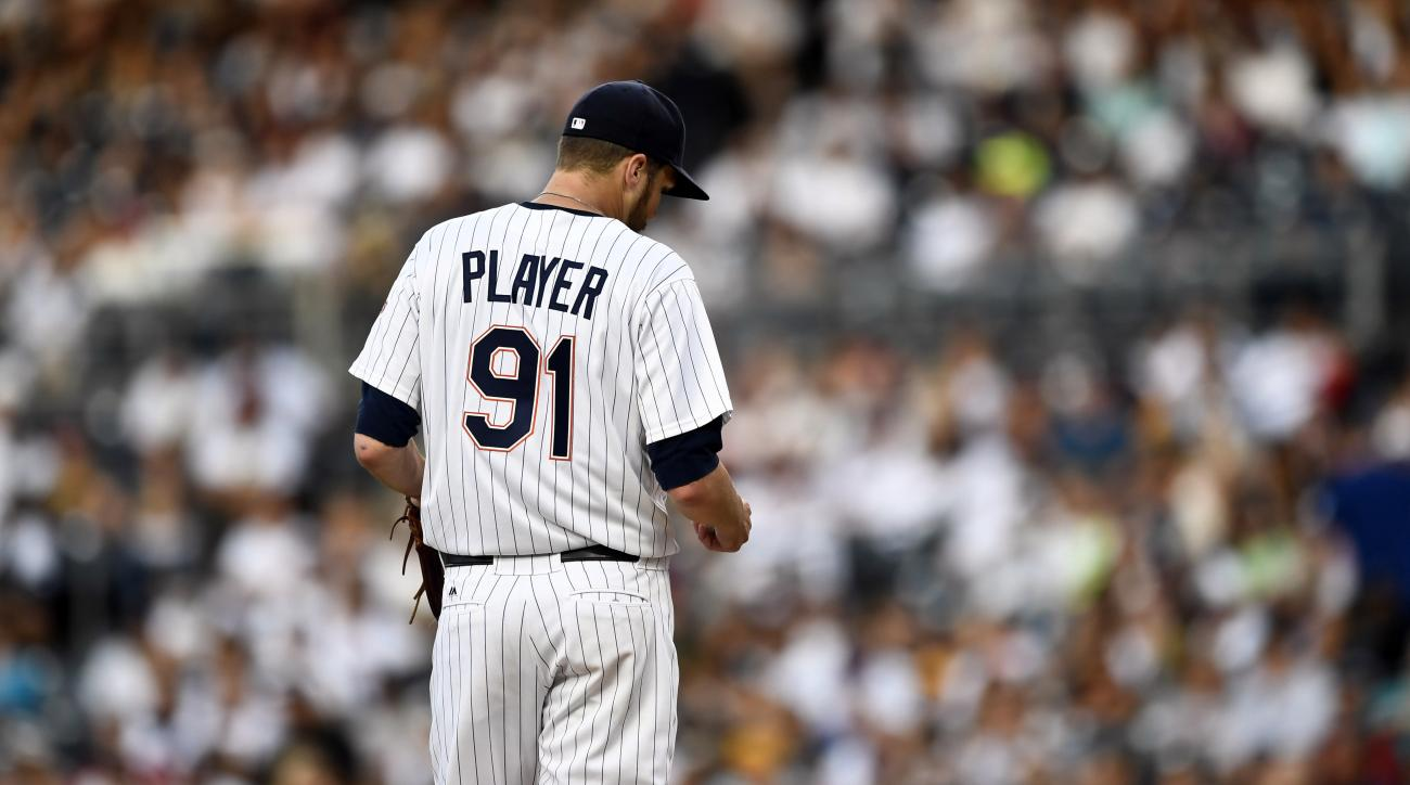 San Diego Padres starting pitcher Paul Clemens stands on the mound during a crucial situation against the Philadelphia Phillies in the fourth inning of a baseball game Saturday, Aug. 6, 2016, in San Diego. Clemens was told to change the jersey by umpire M