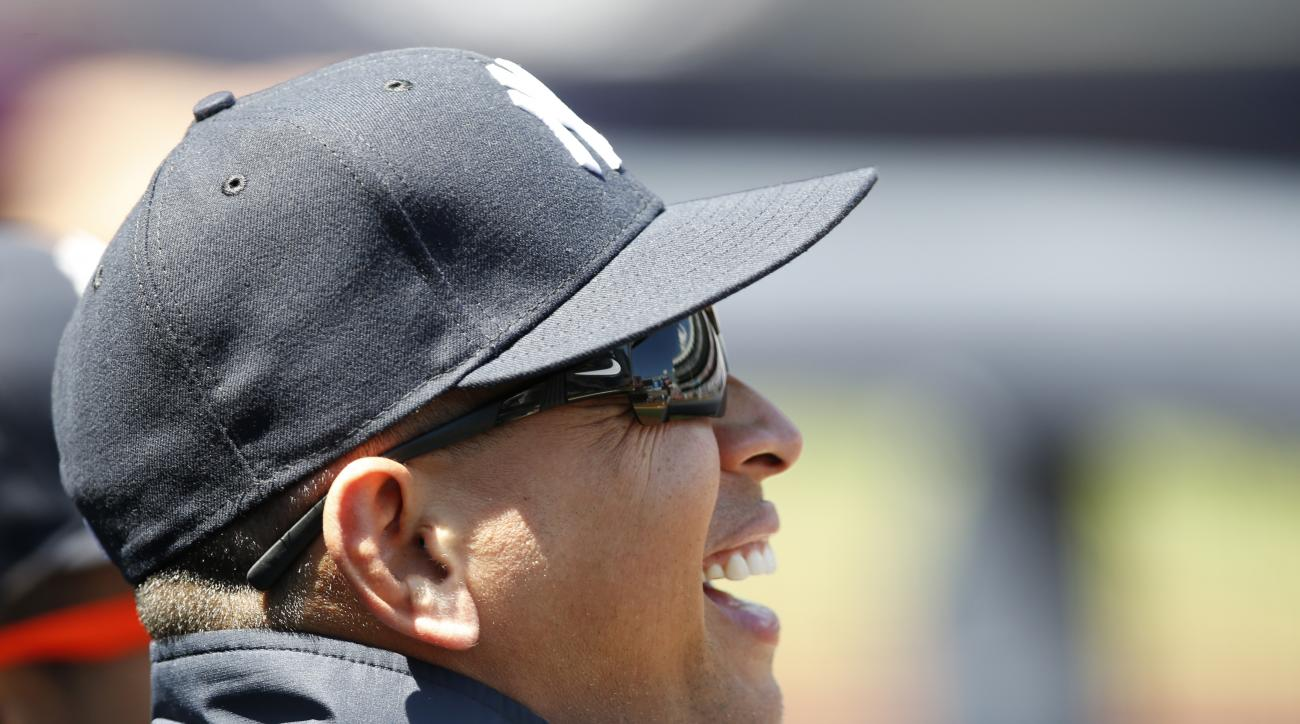 New York Yankees Alex Rodriguez laughs as he watches from the dugout during a baseball game against the Cleveland Indians in New York, Sunday, Aug. 7, 2016. Rodriguez announced Sunday that he will play his final major league game next Friday with the Yank