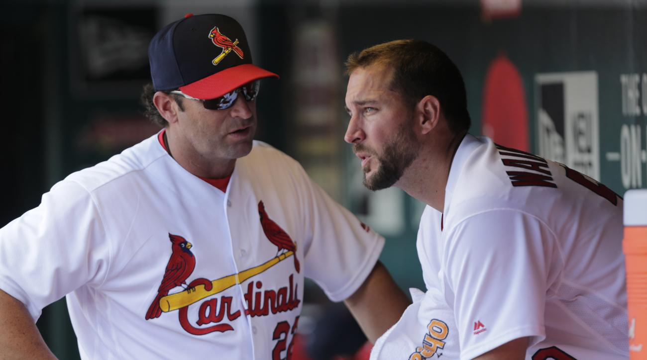 St. Louis Cardinals manager Mike Matheny (22) talks with starting pitcher Adam Wainwright (50), after Wainwright gave up three runs in each of the first two innings, in the second inning of a baseball game against the Atlanta Braves, Sunday, Aug. 7, 2016,