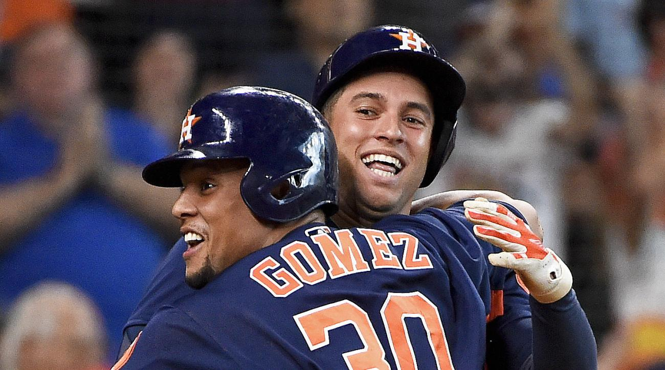 Houston Astros pinch-runner Carlos Gomez, left, celebrates after scoring the tying run on Tony Kemp's single with George Springer in the ninth inning of a baseball game against the Texas Rangers, Sunday, Aug. 7, 2016, in Houston. (AP Photo/Eric Christian