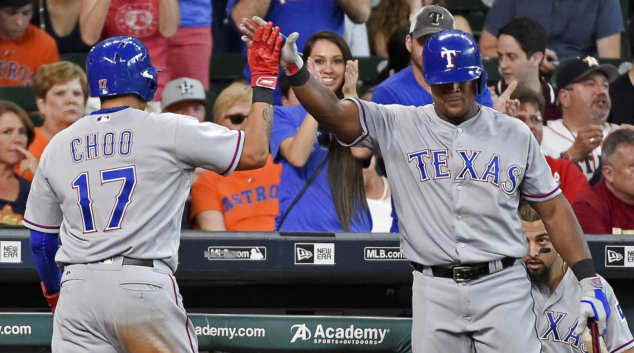 Texas Rangers' Shin-Soo Choo (17) celebrates with Adrian Beltre after scoring the go-ahead run on Ian Desmond's single in the 11th inning of a baseball game against the Houston Astros, Sunday, Aug. 7, 2016, in Houston. (AP Photo/Eric Christian Smith)
