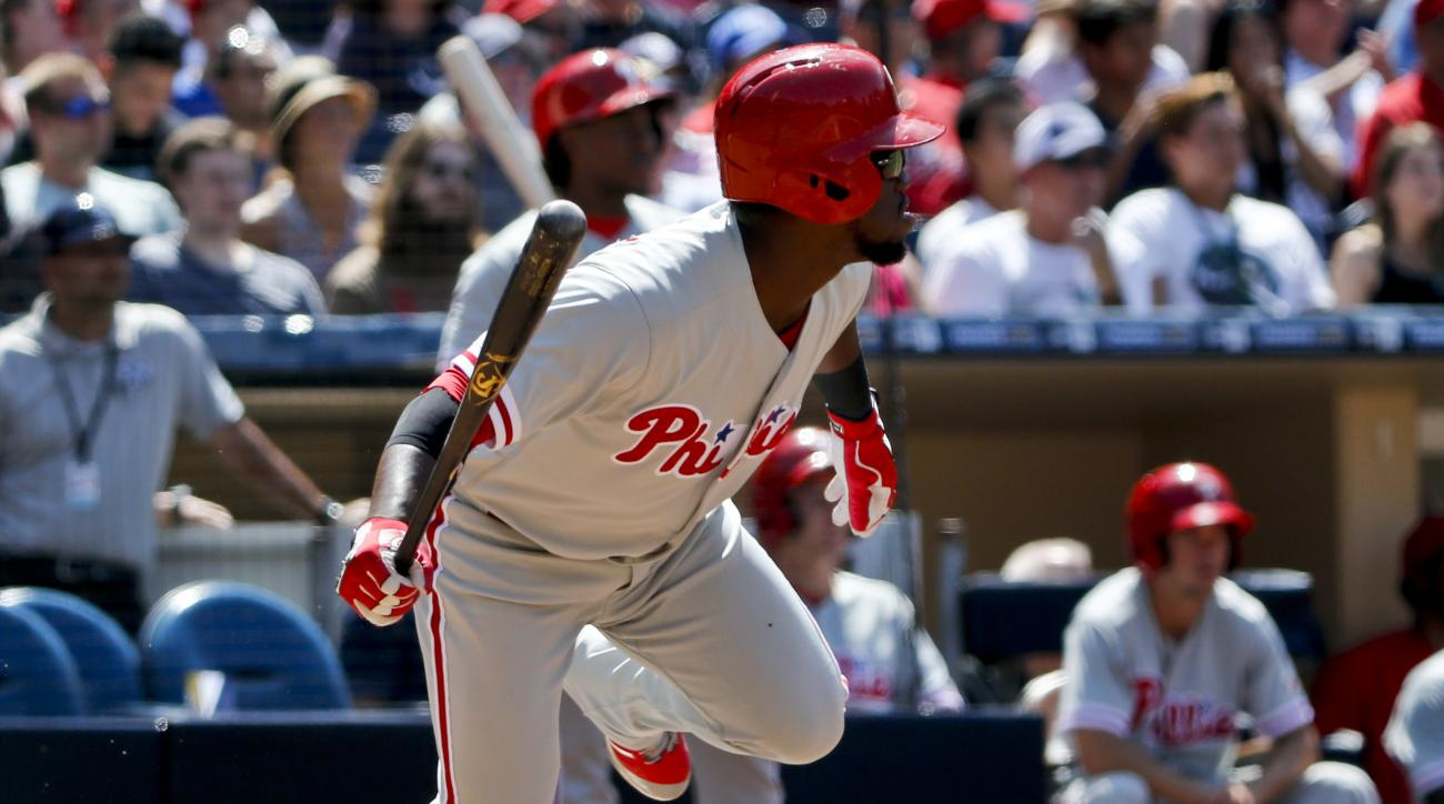 Philadelphia Phillies' Odubel Herrera heads up the line as he watches his run-producing single fall in left field in the fourth inning of a baseball game against the San Diego Padres, Sunday, Aug. 7, 2016, in San Diego. (AP Photo/Lenny Ignelzi)