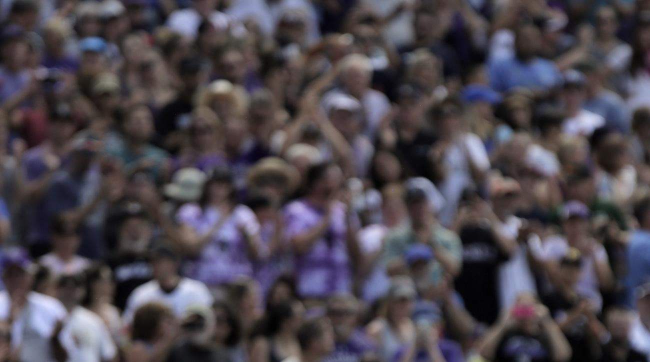 Miami Marlins' Ichiro Suzuki (51) acknowledges the crowd after he hit a triple for the 3,000th hit of his Major League Career in the seventh inning of a baseball game against the Colorado Rockies in Denver on Sunday, Aug. 7, 2016. (AP Photo/Joe Mahoney)