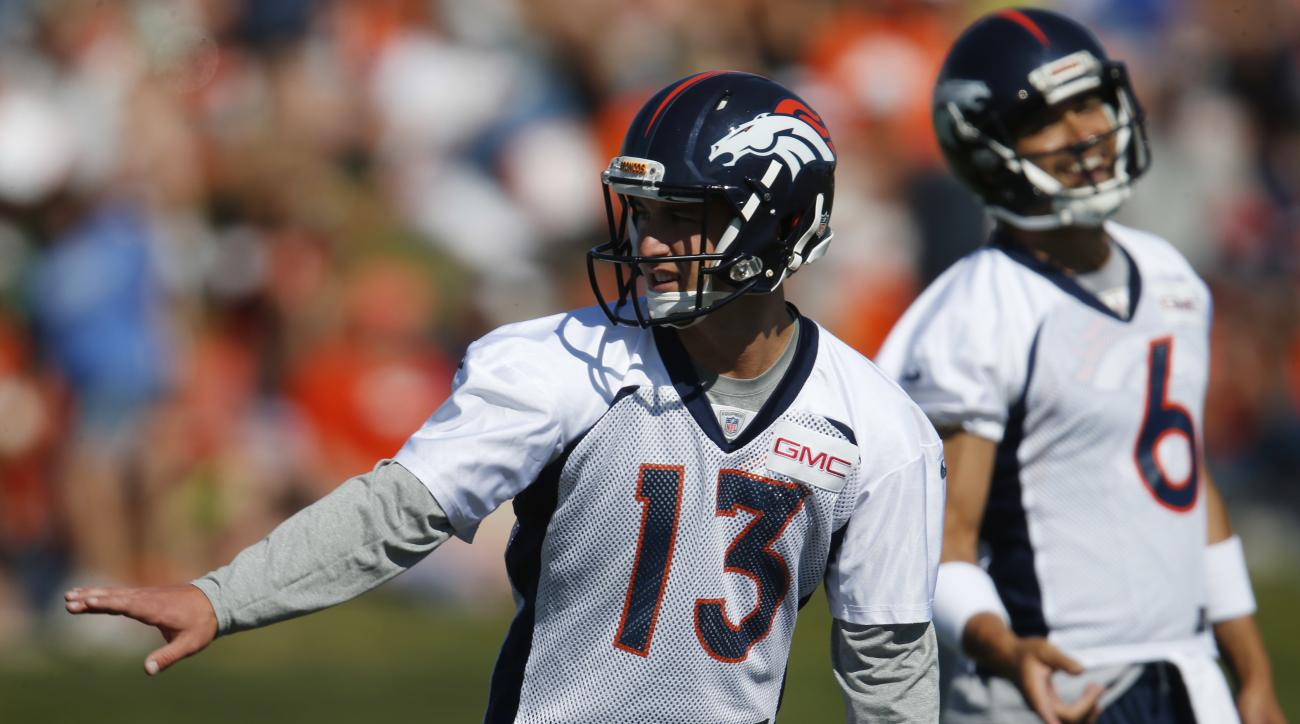 Denver Broncos quarterback Trevor Siemian, front, and quarterback Mark Sanchez (6) take part in drills during the team's NFL football practice Monday, Aug. 8, 2016 in Englewood, Colo. (AP Photo/David Zalubowski)